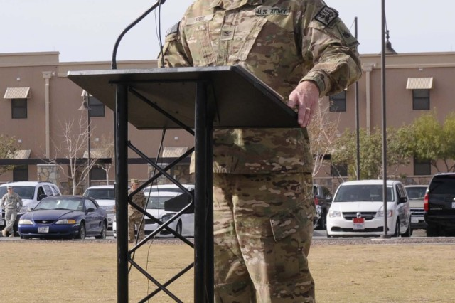 Col. Ken Adgie, 1st Brigade Combat Team, 1st Armored Division brigade commander, speaks during the casing ceremony for the brigade's colors at Fort Bliss, Texas, Dec. 4.  The ceremony was held to signify the brigade's upcoming deployment to Afghanistan.