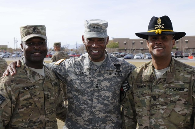 Maj. Gen. Dana J.H. Pittard, 1st Armored Division and Fort Bliss commanding general, center, poses with 1st Sgt. Kenneth Howard, first sergeant of Headquarters and Headquarters Company, 1st Brigade Combat Team, 1st Armored Division, left, and Command Sgt. Maj. Uhuru C. Salmon, 6th Squadron, 1st Cavalry Regiment (Blackhawks) command sergeant major, following the casing ceremony for 1st BCT at Fort Bliss, Texas, Dec. 4.  The ceremony was held to signify the brigade's upcoming deployment to Afghanistan.