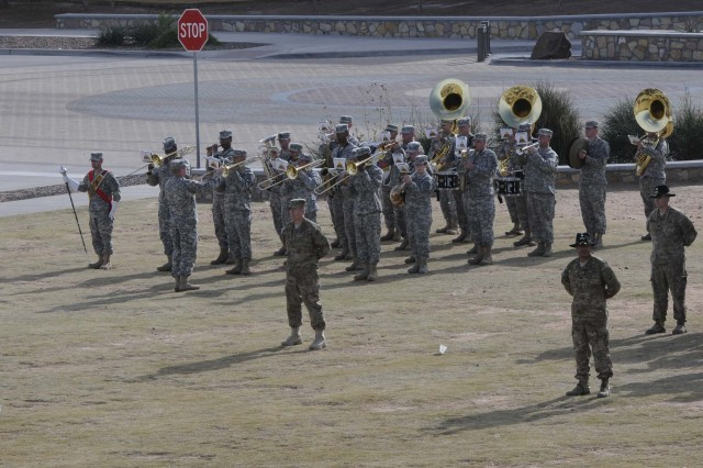 The 1st Armored Division Band performs during the casing ceremony for 1st Brigade Combat Team, 1st Armored Division, at Fort Bliss, Texas, Dec. 4.  The ceremony was held to signify the brigade's upcoming deployment to Afghanistan.