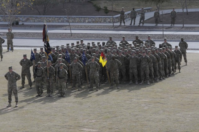 Soldiers from 4th Battalion, 17th Infantry Regiment (Buffalos), stand in formation during the casing ceremony for 1st Brigade Combat Team, 1st Armored Division, at Fort Bliss, Texas, Dec. 4.  The ceremony was held to signify the brigade's upcoming deployment to Afghanistan.