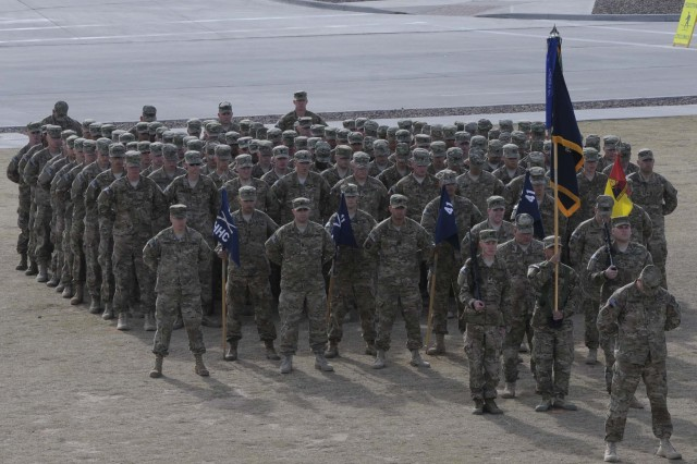 Soldiers from 3rd Battalion, 41st Infantry Regiment (Rifle), stand in formation during the casing ceremony for 1st Brigade Combat Team, 1st Armored Division, at Fort Bliss, Texas, Dec. 4.  The ceremony was held to signify the brigade's upcoming deployment to Afghanistan.