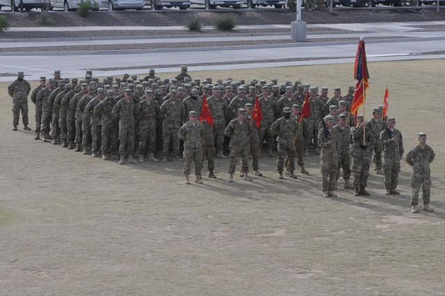 Soldiers from 2nd Battalion, 3rd Field Artillery (Gunners), stand in formation during a casing ceremony for 1st Brigade Combat Team, 1st Armored Division, at Fort Bliss, Texas, Dec. 4.  The ceremony was held to signify the brigade's upcoming deployment to Afghanistan.