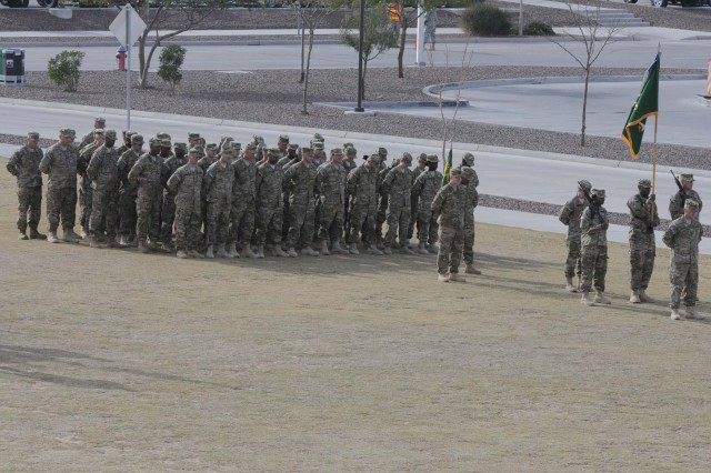 Soldiers from 116th Military Police Battalion stand in formation during the 1st Brigade Combat Team, 1st Armored Division, casing ceremony at Fort Bliss, Texas, Dec. 4.  The brigade cased their colors to signify their upcoming deployment to Afghanistan.