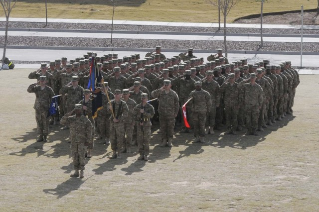 Soldiers from 1st Battalion, 36th Infantry Regiment (Spartans), salute the colors during the casing ceremony for 1st Brigade Combat Team, 1st Armored Division, Dec. 4, at Fort Bliss, Texas.  The brigade is preparing to deploy to Afghanistan.