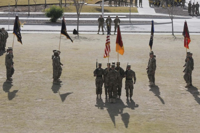 The color guard marches in formation during the casing ceremony for the 1st Brigade Combat Team, 1st Armored Division at Fort Bliss, Texas, Dec. 4.  The ceremony signified the brigade's upcoming deployment to Afghanistan.