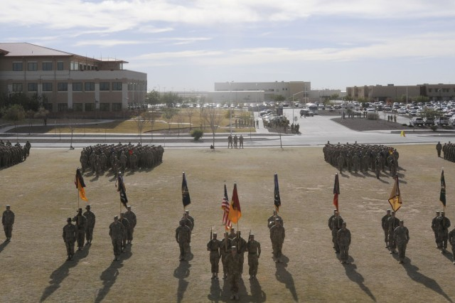 Soldiers from the 1st Brigade Combat Team, 1st Armored Division, stand in formation during the brigade's casing ceremony at Fort Bliss, Texas, Dec. 4.  The ceremony was held to signify the brigade's upcoming deployment to Afghanistan.