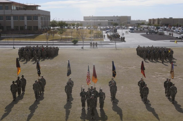 Soldiers stand in formation during the casing ceremony for the 1st Brigade Combat Team, 1st Armored Division at Fort Bliss, Texas, Dec. 4.  The ceremony was held to signify the brigade's upcoming deployment to Afghanistan.