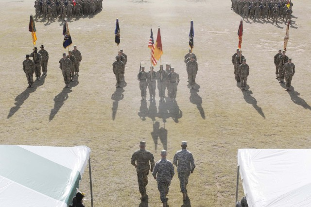 The color guard stands in formation, preparing to case the colors during the casing ceremony for the 1st Brigade Combat Team, 1st Armored Division at Fort Bliss, Texas, Dec. 4.  The casing ceremony was held to signify the brigade's upcoming deployment to Afghanistan.