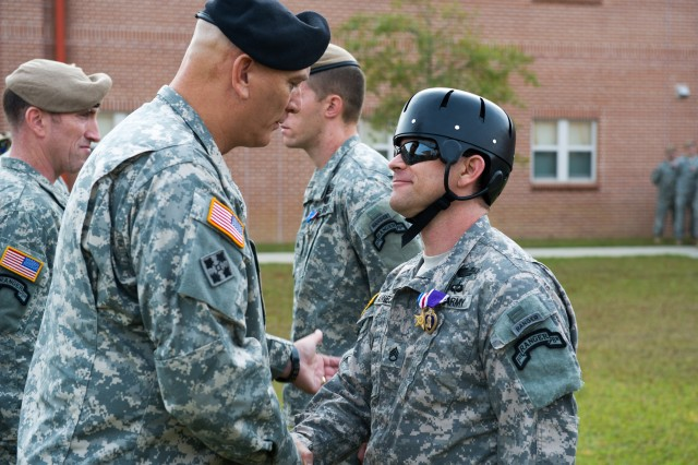 Staff Sergeant Dominic  Annecchini, Co. A, 1/75th Ranger Regt., receives a Silver Star with Valor and a Purple Heart from Gen. Raymond Odierno, chief of staff for the U.S. Army, at an awards ceremony at Hunter Army Airfield, Oct. 26.