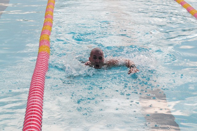 Sgt. 1st Class Jerome MacDonald, Senior Medic, 130th Eng. Bde., 8th TSC, swimming the 200 meter swim during the GAFPB testing, November 5, at Richardson Pool, Schofield Barracks.