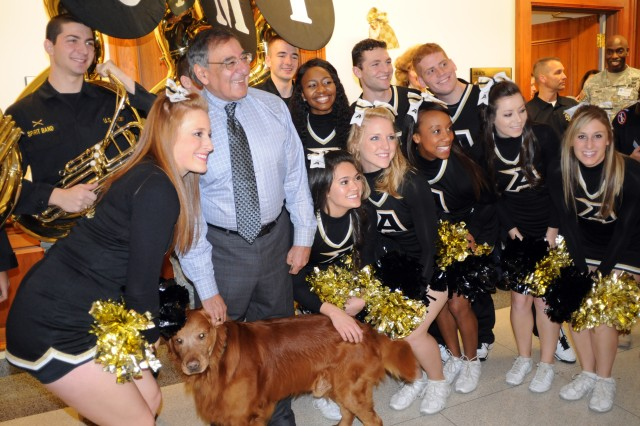 Cadets from the U.S. Military Academy at West Point, N.Y., part of the school's Sprit Band and cheerleading team, met with Secretary of Defense Leon E. Panetta outside his office in the Pentagon, Dec. 7.