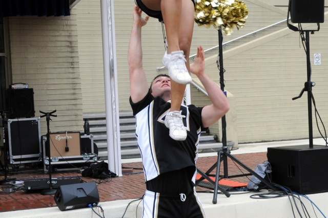 Cadets from the U.S. Military Academy at West Point, N.Y., part of the school's cheerleading team, performed during a pep rally at the Pentagon, Dec. 7.  The cadets visited the Pentagon to rally support for the Dec. 8 Army-Navy game in Philadelphia.