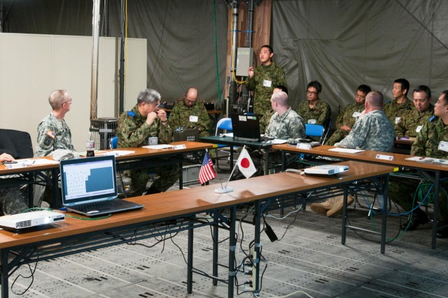 Maj Gen. James Walton, 311th Signal commander, addresses a question from a member of the North Eastern Army during a cyber defense brief during the Yama Sakura 63 exercise. Cyber defense and inoperability are the two main objectives of U.S. Army Pacific Directorate of Information Management.