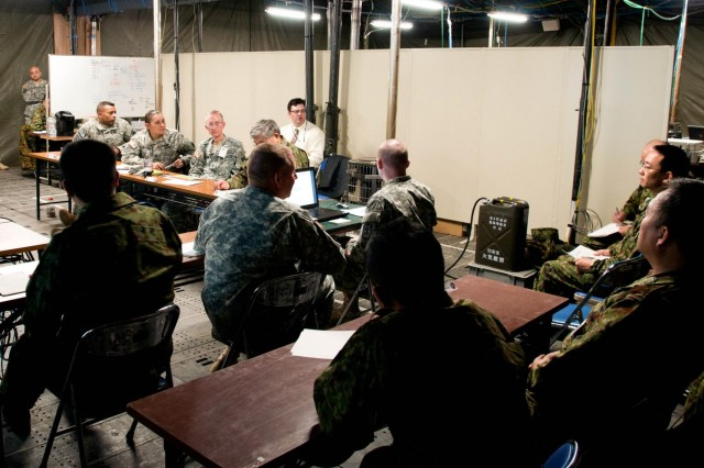 Maj Gen. James Walton, 311th Signal commander, addresses a question from a member of the North Eastern Army during a cyber defense brief during the Yama Sakura 63 exercise. Cyber defense and interoperability are the two main objectives of U.S. Army Pacific Directorate of Information Management.