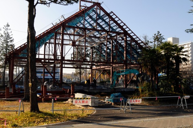 Construction workers rebuild a storied chapel on Camp Sendai following last year's natural disaster.