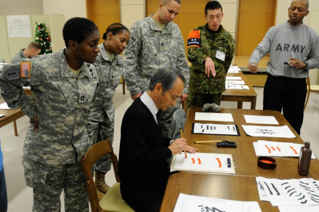 Soldiers participating in Yama Sakura 63 at Camp Sendai, Japan, learn about calligraphy in a recent cultural exchange.