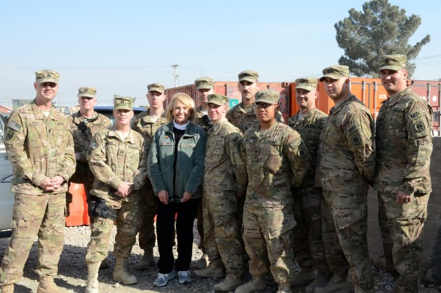 "BAGRAM AIRFIELD, Afghanistan"" Arizona Gov. Janice K. Brewer poses with Soldiers deployed to Afghanistan with the U.S. Army Reserve 539th Military Police Detachment from Buckeye, Ariz., Dec. 6, 2012, at Bagram Airfield. (U.S. Army photo by Staff Sgt. David J. Overson, 115th Mobile Public Affairs Detachment)"