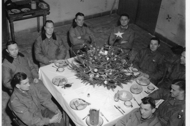 "Brig. Gen. Anthony McAuliffe and his staff gathered inside Bastogne's Heintz Barracks for Christmas dinner Dec. 25th, 1944. This military barracks served as the Division Main Command Post during the siege of Bastogne, Belgium during WWII. The facility is now a museum known as the ""Nuts Cave""."""