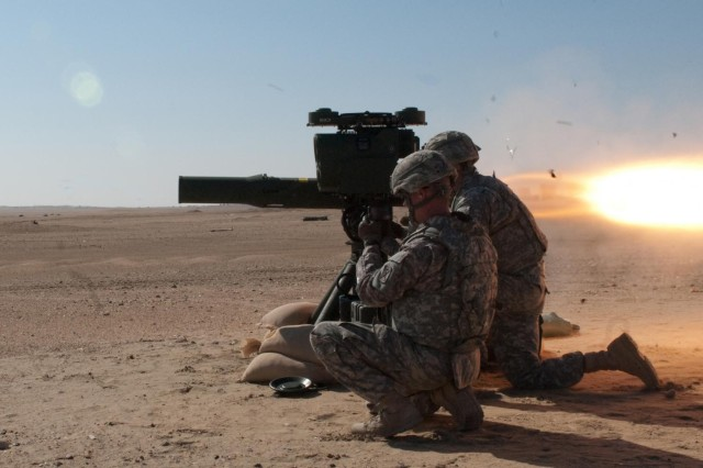 Soldiers of Delta Company, 4th Battalion, 118th Infantry Regiment, engage targets with TOW missiles at the Udairi Range near Camp Buehring, Kuwait, Nov. 27. In addition to performing security-force and camp operations missions, the South Carolina Army National Guard troops have maintained their skills with live-fire training events and exercises since deploying here in April. Based in Marion, S.C., Delta Company wields most of the battalion's heavy weaponry. (U.S. Army photos by Sgt. 1st Class Raymond Drumsta)