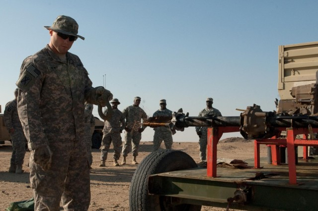 Using a towing shackle, Cpl. Nicholas Orwig, 444th Chemical Company, Illinois Army National Guard, guides TOW missile wire as an engine rewinds it at the Udairi Range near Camp Buehring, Kuwait, Nov. 27. Soldiers of Delta Company, 4th Battalion, 118th Infantry Regiment fired 16 missiles at the range, and 444th Chemical Company soldier Spc. Trent Trowbridge built the device so troops wouldn't have to rewind the wire by hand. Based in Galesburg, Ill., the 444th Chemical Company deployed with the 4th Battalion, which has been performing security-force and camp operations missions in Northern Kuwait since April. Orwig is from Lewistown, Ill. and Trowbridge is from Knoxville, Ill. (U.S. Army photos by Sgt. 1st Class Raymond Drumsta)