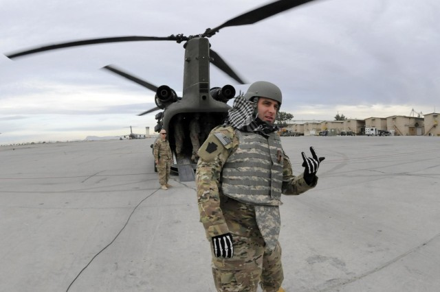 Retired U.S. Army Staff Sgt. Earl Granville gets ready to load onto a CH-47 Chinook helicopter at Kandahar Airfield, Afghanistan, while participating in Operation Proper Exit, Dec. 6, 2012. Operation Proper Exit brings severely wounded service members back to the theater where they sustained their injuries to provide a firsthand progress update on the continuing mission and to help in the healing process. Granville is from Scranton, Pa.  (U.S. Army photo by Staff Sgt. Brendan Mackie)