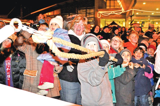 Wiesbaden community members pull the giant switch to turn on the Christmas Tree lights.