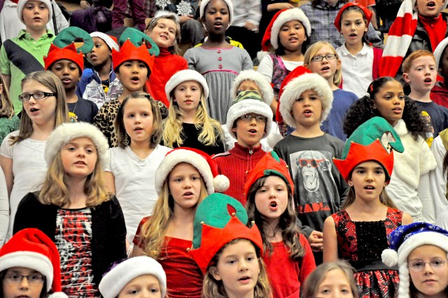 Students from Aukamm and Hainerberg Elementary Schools sing holiday carols during the Wiesbaden military community's tree lighting celebration.