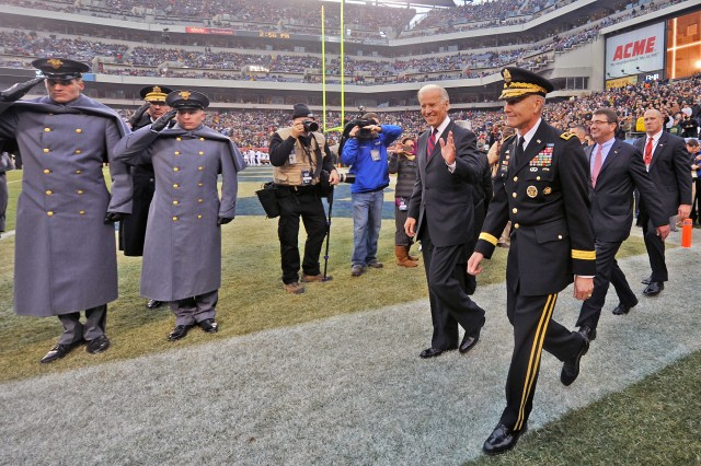 Vice President Joe Biden and Lt. Gen. David H. Huntoon, West Point superintendent, take to the field to perform the coin toss for the 113th Army-Navy gridiron classic at Lincoln Financial Field in Philadelphia, Dec. 8, 2012. Navy won 17-13, extending their winning streak against Army for the 11th straight year.