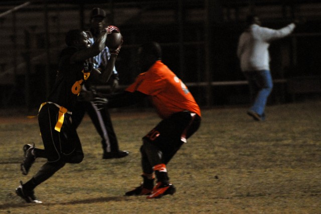 "FORT HOOD, Texas -- Number 69, Spc. Anthony Kearse (left), a motor transport operator, assigned to Fox Forward Support Company, 2nd ""Lancers"" Battalion, 5th Cavalry Regiment, 1st Brigade Combat Team, 1st Cavalry Division, dodges opposing player during the Division Championship Flag Football game, here, Nov. 28. The Lancers won the game with a final score of 26-0 against Soldiers from 157th Quartermaster Company, 4th Sustainment Brigade."