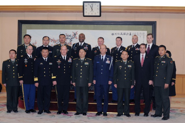 "Group photo is taken at the entrance of the Ministry of National Defense in Beijing Nov. 26. Deputy Chief of the General Staff, Lt. Gen. Qi Jianguo hosted members of the Disaster Management Exchange to luncheon Nov. 26. The DMEs with China began in 1998 with actual visits beginning in 2005. The 2012 DME is hosted by the People's Liberation Army in China: Beijing, Kunming, and Chengdu. U.S. Army Pacific and the PLA are participating in DME, Nov. 26 "" Dec. 2. The DME is an annual USARPAC Security Cooperation Event with the People's Republic of China (PRC) and the People's Liberation Army (PLA). The DMEs with China began in 1998 with actual visits beginning in 2005. For the 2007 DME, the PLA hosted a USARPAC delegation in China (Beijing and Wuhan). For the 2011 DME, USARPAC hosted the PLA in Hawaii, Colorado, and Louisiana."