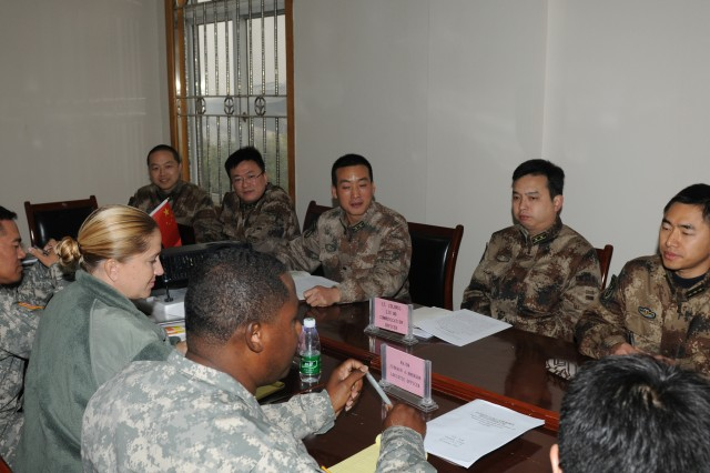 The U.S. Army Pacific and the People's Liberation Army participated in the first Joint Humanitarian Assistance and Disaster Relief Tabletop Exercise Nov. 29 - 30 at the Sichuan Provincial Military Command Training Base under Chengdu Military Command.  Members gather together to discuss logistics during a breakout session. The exercise scenario was based on a fictional third party nation with 'City C' having a 7.8 earthquake with widespread destruction and loss of life. The tabletop exercise was part of a Disaster Management Exchange Nov. 26 - Dec. 2 between the PLA and U.S. Army Pacific. The 2012 DME was hosted by the PLA in three locations in China: Beijing, Kunming, and Chengdu. The DME is an annual USARPAC security cooperation event  with the People's Republic of China and the PLA. The DMEs with China began in 1998 with actual visits beginning in 2005.