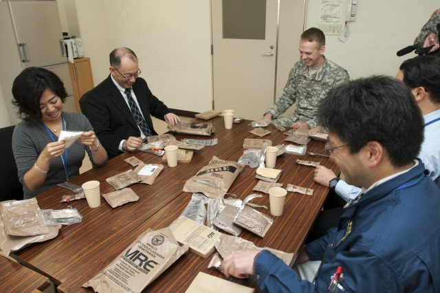 While visiting Camp Sendai for the Yama Sakura 63 bilateral training exercise, Stephen Lowell, U.S Army Japan, host nation relations officer, invited Iga and Kitahara for a luncheon and provided the opportunity for them to eat their first U.S. military MRE.