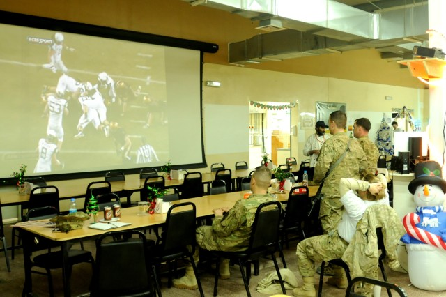 "LAGHMAN PROVINCE, Afghanistan "" West Point alumni from 4th Brigade Combat Team, 1st Cavalry Division and 1st Brigade Combat Team, 101st Airborne Division, watch the 2012 Army-Navy football game in the middle of the night at an empty dining facility at Forward Operating Base Gamberi, Afghanistan, Dec. 8, 2012.  (U.S. Army photo by Maj. Steven Miller, 4th BCT, 1st Cav. Div. Public Affairs)"