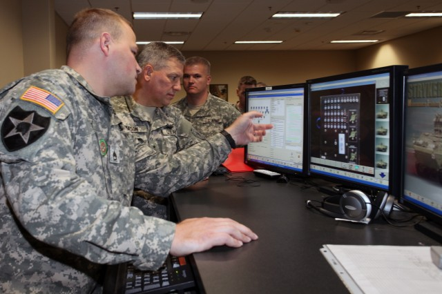 Staff Sgt. Derek Eich, Stryker maintenance course instructor, demonstrates the interactive classroom training to Lt. Gen. Raymond V. Mason, U.S. Army deputy chief of staff, G-4 (Logistics), during a visit here Dec. 7. Students in the Stryker maintenance course virtually troubleshoot problems with the vehicle before participating in the hands-on portion. Instructors can monitor all the students' progress from a main control station.
