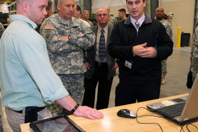 Matthew Maclaughlin, Combined Arms Support Command Technology Integration Branch chief, explains to Lt. Gen. Raymond V. Mason, U.S. Army deputy chief of staff, G-4 (Logistics), some of the many applications his section creates for mobile devices Dec. 7. The apps enable students to enhance their training in a variety of subjects from their mobile and wireless devices.