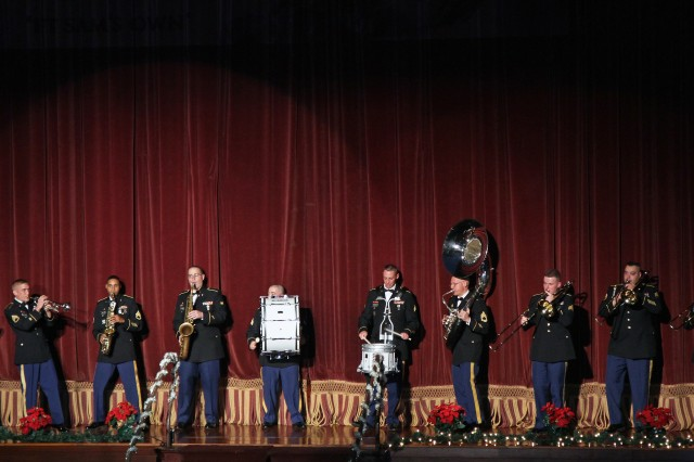 "SAN ANTONIO - The award-winning ""Biohazard Brass Band,"" of the 323rd Army Band, performs an arrangement of ""Deck the Halls,"" during ""A Holiday Celebration,"" at the Scottish Rite Auditorium Dec. 8. Afterward, the jazz band played ""Jolly Old St. Nicholas,"" and on cue, Santa made an appearance and passed out candy canes to the children in the auditorium.  (U.S. Army photo by Staff Sgt. Keith Anderson, Army North PAO)"