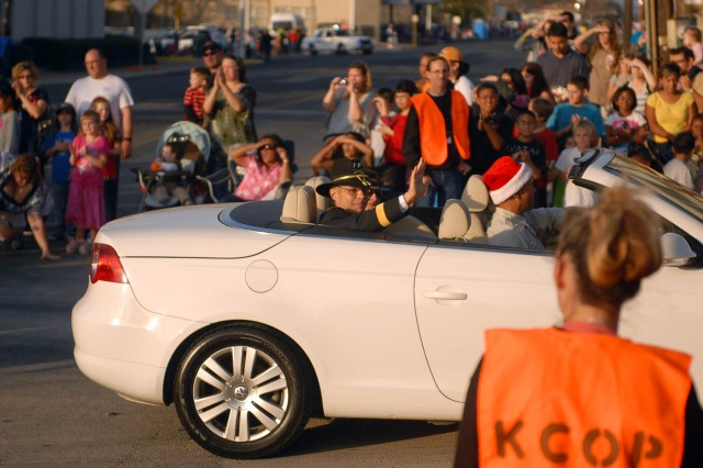 KILLEEN, Texas--Maj. Gen. Anthony Ierardi, commanding general of the 1st Cavalry Division, waves as he passes onlookers during Killeen's 50th Annual Christmas Parade, here, Dec. 8. Ieradi served as the parade grand marshal.