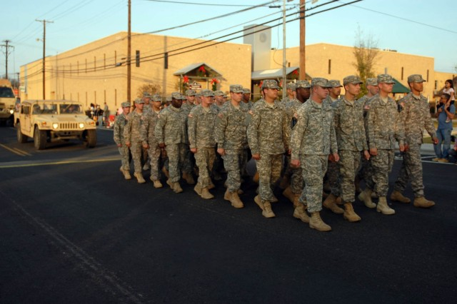 KILLEEN, Texas--Soldiers from the 1st Squadron, 7th Cavalry Regiment and the 5th Battalion, 82nd Field Artillery Regiment both with the 1st Brigade Combat Team, 1st Cavalry Division, participate in Killeen's 50th Annual Christmas Parade, here, Dec. 8.