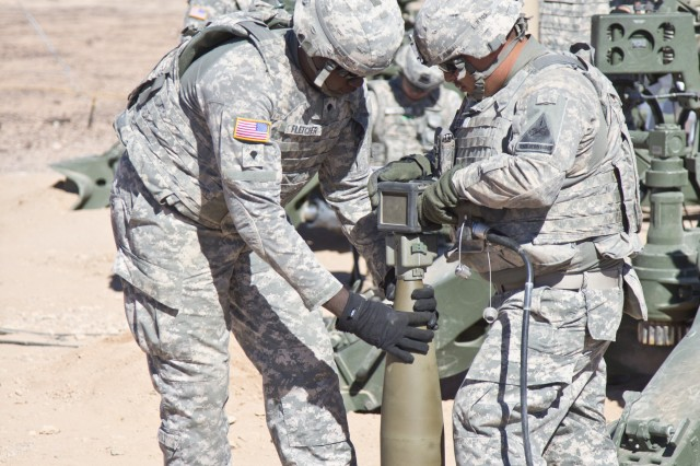 Soldiers from the 4th Battalion, 27th Field Artillery Regiment, from Fort Bliss, Texas, set the Precision Guidance Kit Fuze during an Early User Assessment at Yuma Proving Grounds, Ariz., in October 2012.