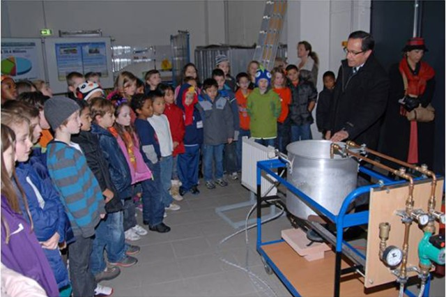 Children from Grafenwoehr Elementary School tour the Grafenwoehr Central Heating Plant on Oct. 31 to learn how natural gas provides heat and hot water to the garrison.