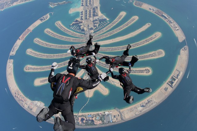 Golden Knight Female 4-Way Team and photographer Sgt. 1st Class Scott Janise fly over the Palm in Dubai in the United Arab Emirates.
