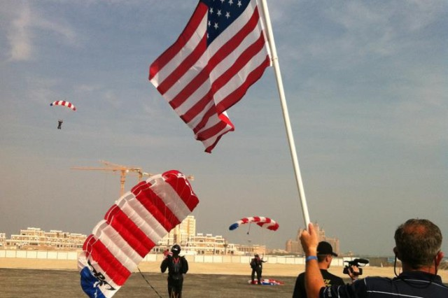 U.S. competitors land with red, white and blue parachutes.