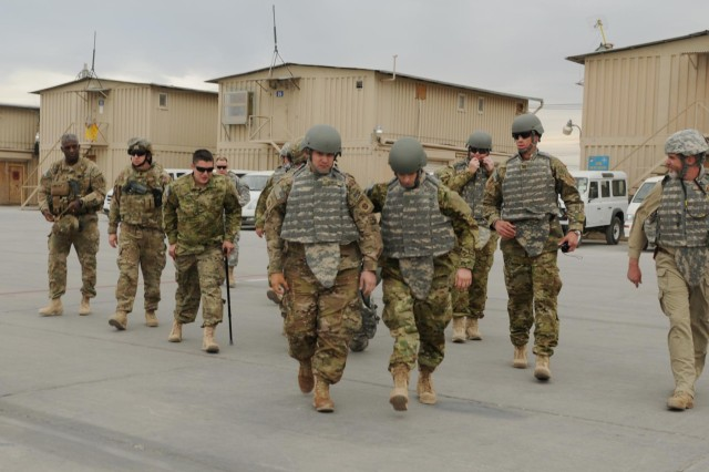 A group of Soldiers and Marines participating in Operation Proper Exit prepare to board a CH-47 Chinook helicopter on Kandahar Airfield, Afghanistan, bound for Camp Nathan Smith, Dec. 6, 2012. Operation Proper Exit brings severely wounded service members back to the theater where they sustained their injuries to provide a firsthand progress update on the continuing mission and to help in the healing process. (U.S. Army photo by Sgt. Ashley Curtis)