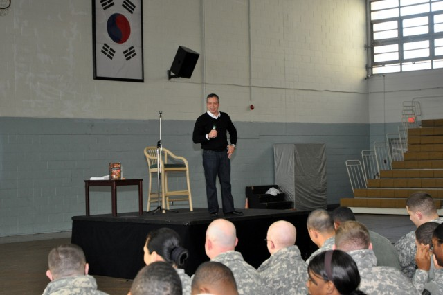 Bernie McGrenahan, a stand-up comedian, gives a show about suicide and alcohol abuse prevention at U.S. Army Garrison Yongsan Collier Community Fitness Center here, Dec. 10. (U.S. Army photo by Cpl. Lee Hyokang)