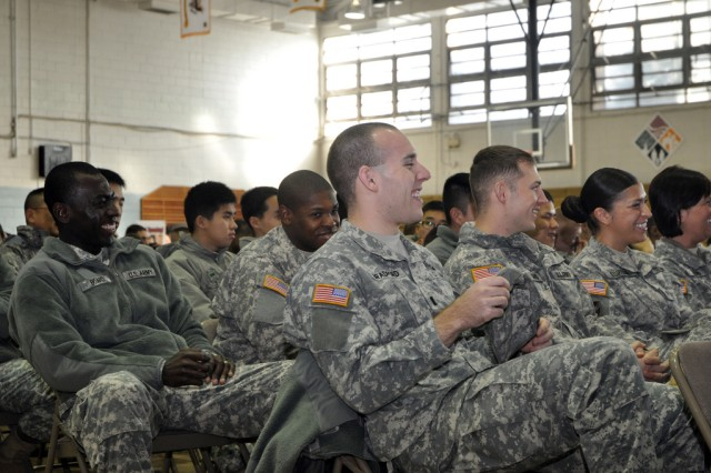 Soldiers stationed at U.S. Army Garrison Yongsan have a meaningful time at Bernie McGrenahan's comedy show, while learning about suicide and alcohol abuse prevention, Dec. 10. (U.S. Army photo by Cpl. Lee Hyokang)