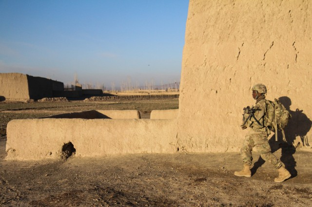 """PAKTYA PROVINCE, Afghanistan - Spc. Nigel Rose, an infantryman and 240B gunner assigned to Company D, 1st Battalion, 187th Infantry Regiment, 3rd Brigade Combat Team """"Rakkasans,"""" 101st Airborne Division (Air Assault), conducts a foot patrol during an Afghan National Security Forces-led mission in Zormat District, Afghanistan, Dec. 10, 2012.The operation was aimed at disrupting a suspected insurgent safe haven within the district. During the mission, the ANSF detained several suspected insurgents and destroyed more than 80 lbs of home-made explosive material. (U.S. Army photo by Sgt. 1st Class Abram Pinnington, Task Force 3/101 Public Affairs)"""