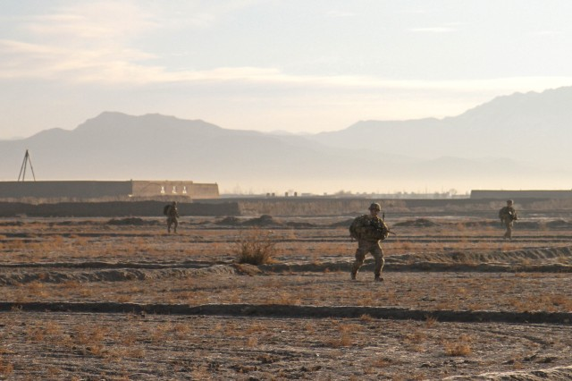 """PAKTYA PROVINCE, Afghanistan - Soldiers  assigned to Company D, 1st Battalion, 187th Infantry Regiment, 3rd Brigade Combat Team """"Rakkasans,"""" 101st Airborne Division (Air Assault), conduct a foot patrol during an Afghan National Security Forces led mission in Zormat District, Afghanistan, Dec. 10, 2012.The operation aimed at disrupting an suspected insurgent safe haven within the district. During the mission, the ANSF detained several suspected insurgents and destroyed more than 80 lbs of home-made explosive material. (U.S. Army photo by Sgt. 1st Class Abram Pinnington, Task Force 3/101 Public Affairs)"""