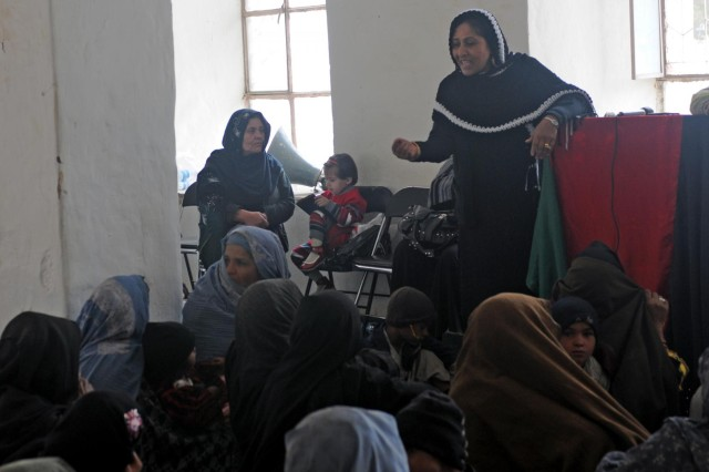 Roquia Achekzai, the Director of Women's Affairs for Kandahar province speaks with local women during a women's meeting at the Spin Boldak District Center, Kandahar province, Afghanistan, Dec. 7, 2012. The meeting, led by female Afghan leaders from the Government of the Islamic Republic of Afghanistan, non-government organizations and other local professional women, was held in conjunction with the international 16 Days of Activism Against Gender Violence Campaign which runs from Nov. 25 to Dec. 10. Women discussed topics such as women's rights, education, access to medical care and hygiene.