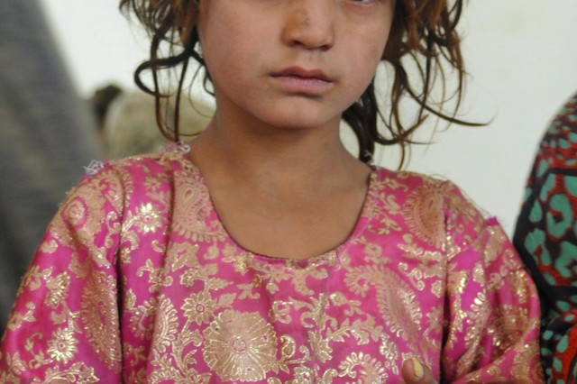 An Afghan girl waits inside the gathering area of a women's meeting at the Spin Boldak District Center, Kandahar province, Afghanistan, Dec. 7, 2012. The meeting, led by female Afghan leaders from the Government of the Islamic Republic of Afghanistan, non-government organizations and other local professional women, was held in conjunction with the international 16 Days of Activism Against Gender Violence Campaign which runs from Nov. 25 to Dec. 10. Women discussed topics such as women's rights, education, access to medical care and hygiene.