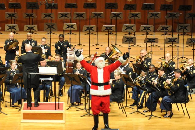Santa Claus makes an apprearance with the Eighth Army Band during the annual holiday concert at the Seoul Performing Art Center in South Korea Dec. 9.
